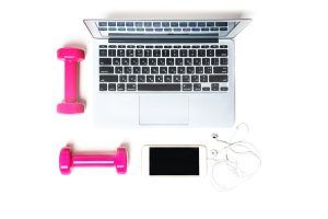 Laptop with dumbbells and cell phone