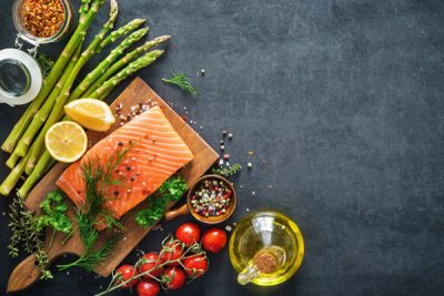 Salmon on a Charcuterie board with decorative vegetables
